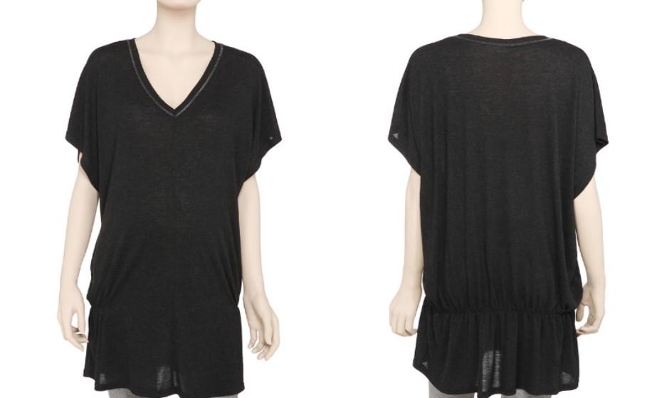 O preto dá um ar elegante e sofisticado a qualquer outfit e não é por estar grávida que tem de deixar esta cor no armário. Na imagem: blusa tricô da Pré Natal.