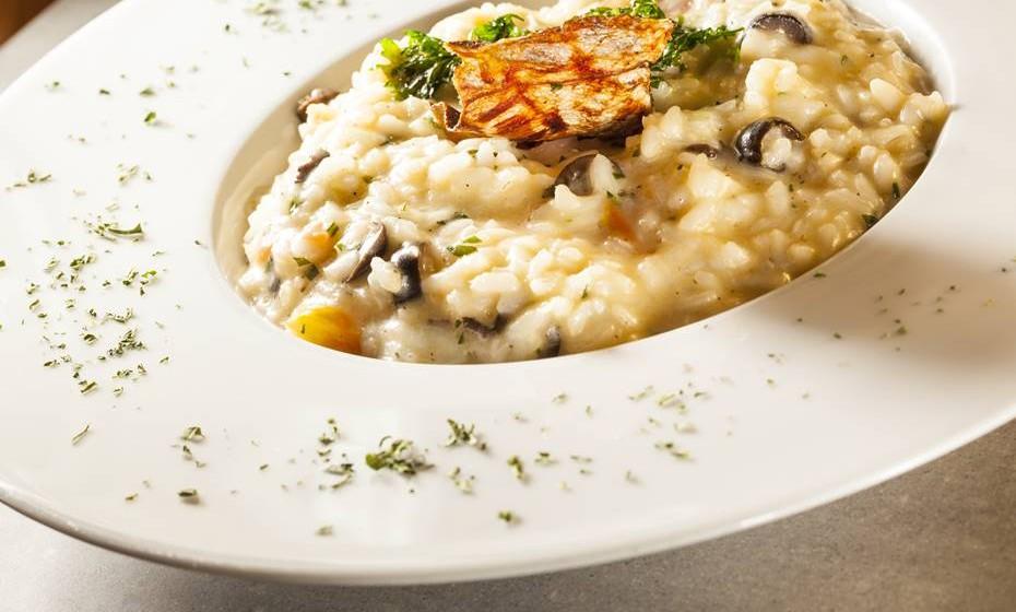 risotto-con-baccala-affumicato-pomodorini-semi-confit-olive-nere-e-coriandolo