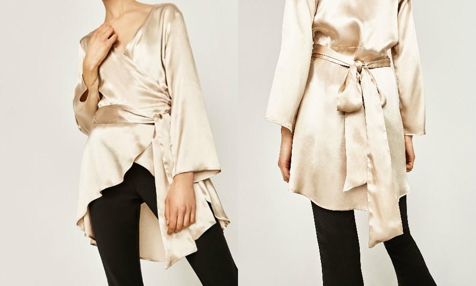Para um look mais clássico e elegante, esta blusa tipo quimono é perfeita. Dá luz de forma mais contida. (Na imagem, look Zara)