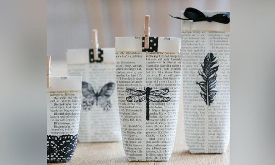 O jornal também poderá ser reaproveitado. Aproveite as folhas para dar um formato como o da imagem. Pode pintar com os seus motivos favoritos e decorar com molas e laços.  Fonte: http://www.lisbet-e.net/