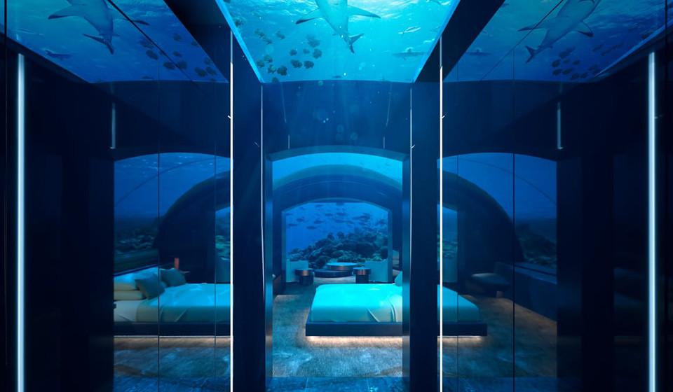 Vista do hall para o quarto, na qual é possível observar a vida marinha presente naquele Oceano.
