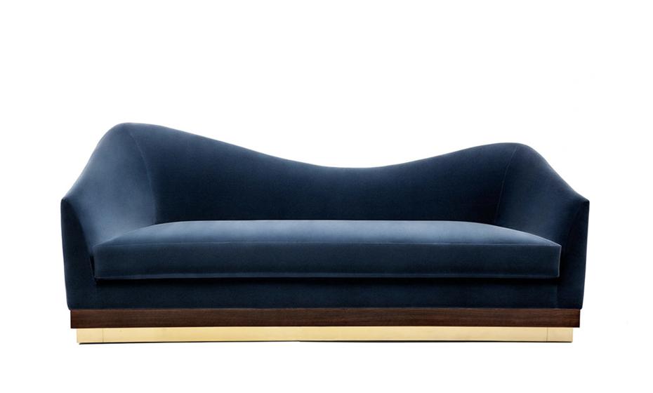 Se gosta de arrojar que tal colocar um sofá azul? Fonte: Munna.