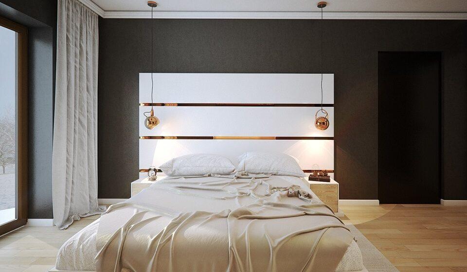 2. Parede preta com o cobre na cabeceira da cama e nos pendentes de cobre a ser a estrela