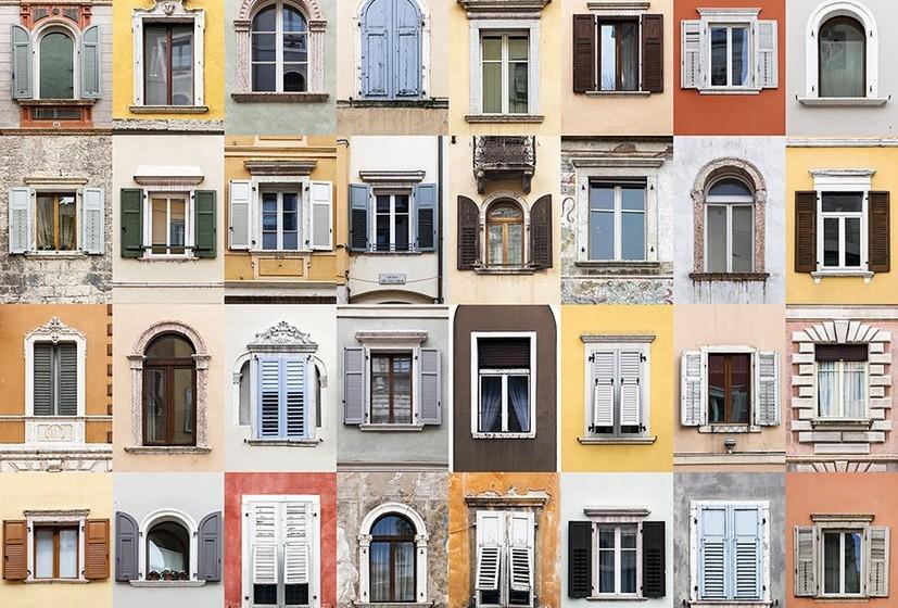 Na imagem, janelas de Trento, Itália.